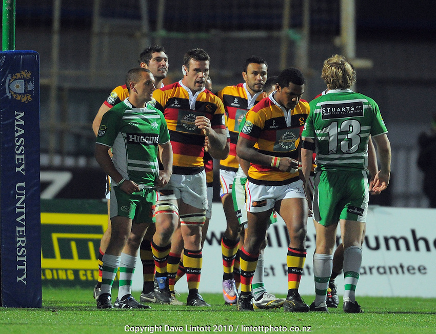 Waikato's Stephen Donald (second left) celebrates scoring his first try as he walks past Manawatu's Aaron Cruden (left). ITM Cup rugby - Manawatu Turbos v Waikato at FMG Stadium, Palmerston North, New Zealand on Thursday, 14 October 2010. Photo: Dave Lintott / lintottphoto.co.nz
