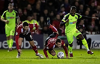 Bolton Wanderers' Joe Dodoo (right) competing with Lincoln City's Harry Toffolo (centre) <br /> <br /> Photographer Andrew Kearns/CameraSport<br /> <br /> The EFL Sky Bet League One - Lincoln City v Bolton Wanderers - Tuesday 14th January 2020  - LNER Stadium - Lincoln<br /> <br /> World Copyright © 2020 CameraSport. All rights reserved. 43 Linden Ave. Countesthorpe. Leicester. England. LE8 5PG - Tel: +44 (0) 116 277 4147 - admin@camerasport.com - www.camerasport.com