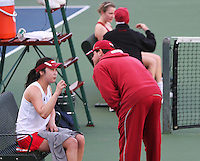 STANFORD, CA - January 29, 2011:  Veronica Li gets some instruction from Associate Head Coach Frankie Brennan during Stanford's 6-1 victory over Oklahoma at Stanford, California on January 29, 2011.