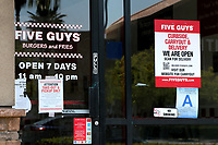 LOS ANGELES - APR 11:  Five Guys Store and Signage at the Businesses reacting to COVID-19 at the Hospitality Lane on April 11, 2020 in San Bernardino, CA