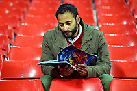 A Liverpool fan reads his programme<br /> <br /> Photographer Richard Martin-Roberts/CameraSport<br /> <br /> UEFA Champions League Group C - Liverpool v Napoli - Tuesday 11th December 2018 - Anfield - Liverpool<br />  <br /> World Copyright © 2018 CameraSport. All rights reserved. 43 Linden Ave. Countesthorpe. Leicester. England. LE8 5PG - Tel: +44 (0) 116 277 4147 - admin@camerasport.com - www.camerasport.com