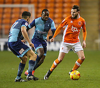 Blackpool's Mark Yeates gets away from Wycombe Wanderers' Myles Weston and Luke O'Nien<br /> <br /> Photographer Alex Dodd/CameraSport<br /> <br /> Checkatrade Trophy Round 3 Blackpool v Wycombe Wanderers - Tuesday 10th January 2017 - Bloomfield Road - Blackpool<br />  <br /> World Copyright &copy; 2017 CameraSport. All rights reserved. 43 Linden Ave. Countesthorpe. Leicester. England. LE8 5PG - Tel: +44 (0) 116 277 4147 - admin@camerasport.com - www.camerasport.com
