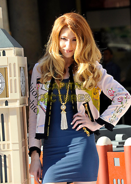 Nicola Roberts .At the Mastercard unveiling of a pop up version of 'Priceless London' in Covent Garden to celebrate the Mastercard programme giving card holders exclusive access and experiences to the very best of London's museums, theatres, music, restaurants and attractions, London, England..September 29th 2011.half length blue dress print white jacket necklace hand on hip big ben.CAP/ROS.©Steve Ross/Capital Pictures