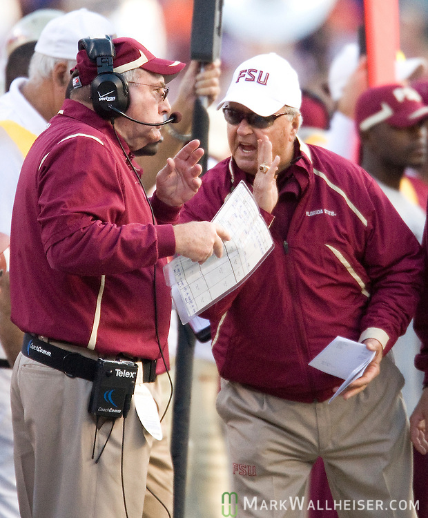 Florida State head coach Bobby Bowden (R) talks with defensive coordinator Mickey Andrews in the first half of the annual Florida vs Florida State NCAA football game in Gainesville, Florida November 28, 2009.  The Florida Gators defeated the Florida State Seminoles 37-10 for the 5th year in a row.
