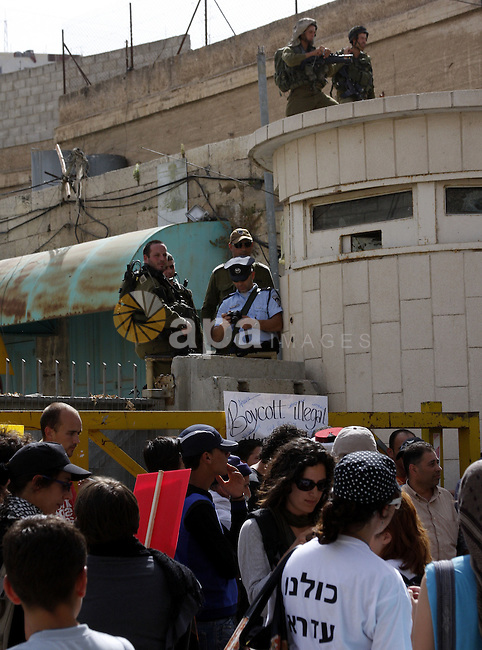 Israeli left-wing activists and Palestinians protest against Jewish settlements and Shuhada street closing near Beit Romano settlement in the city center of the West Bank city of Hebron on May 22, 2010. Photo by Mamoun Wazwaz