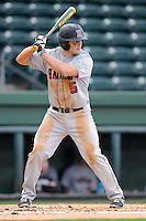 Designated hitter Ethan Ferreira (5) of the Harvard Crimson bats in a game against the Michigan State Spartans on Saturday, March 15, 2014, at Fluor Field at the West End in Greenville, South Carolina. Michigan State won, 4-0. (Tom Priddy/Four Seam Images)