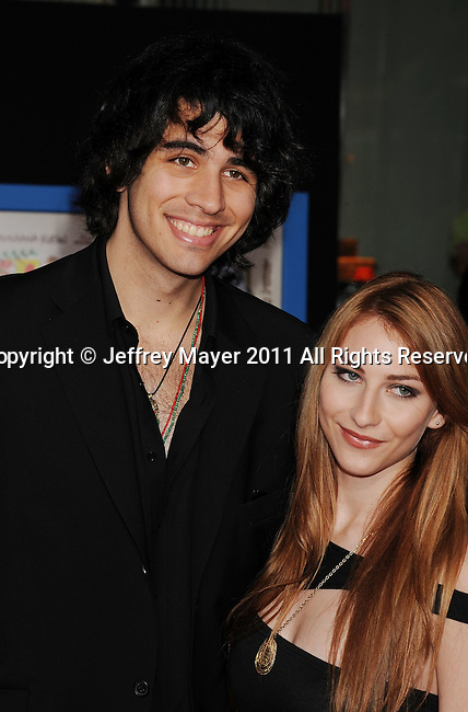 "HOLLYWOOD, CA - APRIL 21: Nick Simmons and guest arrive to the ""Prom"" World Premiere at the El Capitan Theatre on April 21, 2011 in Hollywood, California."