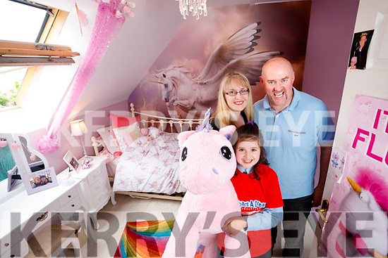 Sarah Carthy with her parents Edward and Anne at their home in Ballyrickard on Wednesday.
