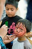 Face-painting at Church Street Summer Festival, London.