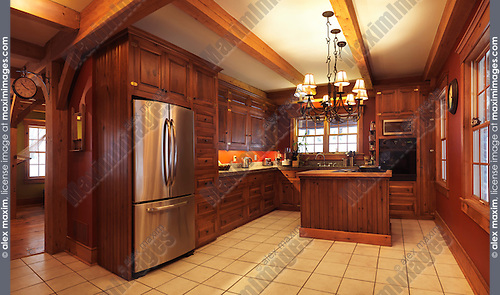 Spacious kitchen interior with lots of wood cabinets and elements in a timberframe Canadian country house in rustic country architectural style, Muskoka, Ontario, Canada