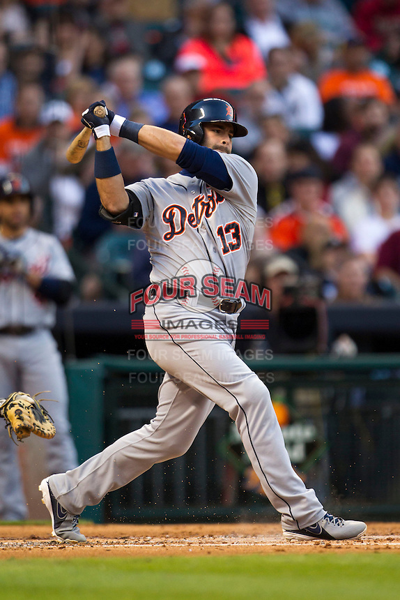 Detroit Tigers catcher Alex Avila (13) swings the bat during the MLB baseball game against the Houston Astros on May 3, 2013 at Minute Maid Park in Houston, Texas. Detroit defeated Houston 4-3. (Andrew Woolley/Four Seam Images).