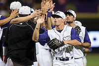Adam Engel (7) of the Winston-Salem Dash high fives teammates after their win over the Myrtle Beach Pelicans at BB&T Ballpark on September 9, 2015 in Winston-Salem, North Carolina.  The Dash defeated the Pelicans 4-2 to take a 1-0 lead in the best of 3 series. (Brian Westerholt/Four Seam Images)