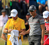 Henrik Stenson (SWE) and caddy Gareth Lord on the 14th green during Thursday's Round 1 of the 145th Open Championship held at Royal Troon Golf Club, Troon, Ayreshire, Scotland. 14th July 2016.<br /> Picture: Eoin Clarke | Golffile<br /> <br /> <br /> All photos usage must carry mandatory copyright credit (&copy; Golffile | Eoin Clarke)