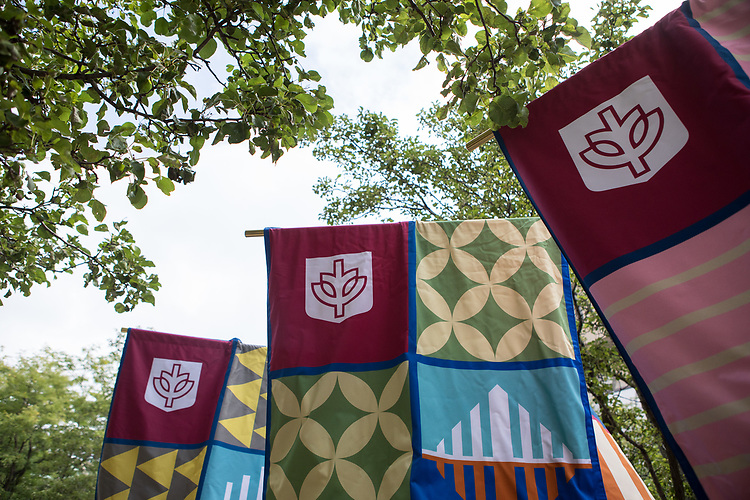 Banners representing the colleges and schools lead the faculty and staff procession from the Quad for the 120th DePaul University Convocation on Thursday, August 31, 2017, at St. Vincent de Paul Parish Church. (DePaul University/Jeff Carrion)