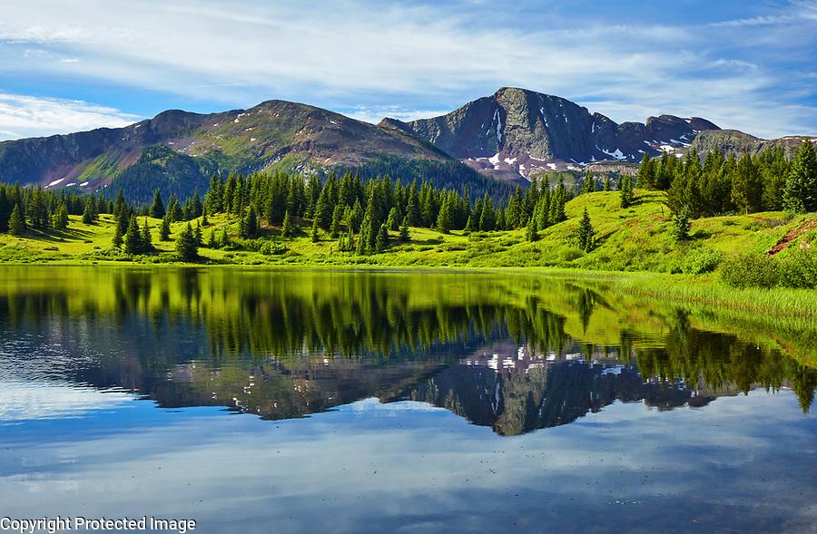 Morning reflections at Little Molas Lake, located at Molas Pass in the San Juan mountains near Durango, Colorado