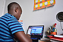 MIRAMAR, FL - MARCH 31: Broward County 9 year old student Jordan in his bedroom in front of his laptops during distance virtual school learning amid Coronavirus Pandemic in Broward County, Florida Public Schools. Florida began their experience with online virtual distance learning, amid the growing coronavirus pandemic on March 31, 2020 in Miramar, Florida.   ( Photo by Johnny Louis / jlnphotography.com )