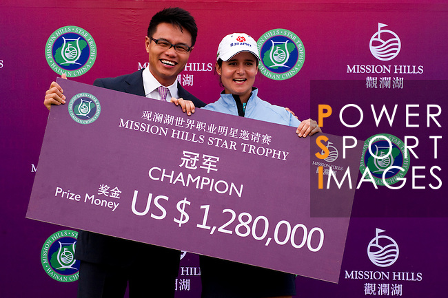 HAIKOU, CHINA - OCTOBER 31:  Lorena Ochoa (L) of Mexico poses with Dr. Ken Chu, Vice Chairman of Mission Hills Group after winning the Mission Hills Start Trophy at Mission Hills Resort on October 31, 2010 in Haikou, China.  The Mission Hills Star Trophy is Asia's leading leisure liflestyle event and features Hollywood celebrities and international golf stars. Photo by Victor Fraile / The Power of Sport Images