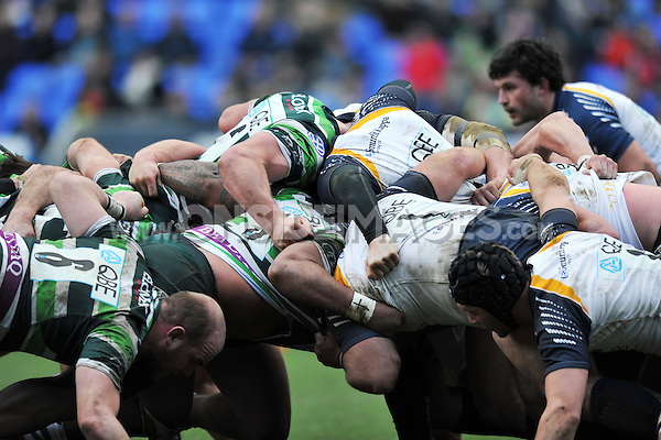 The London Irish and Worcester Warriors packs engage in a scrum. LV= Cup match, between London Irish and Worcester Warriors on January 27, 2013 at the Madejski Stadium in Reading, England. Photo by: Patrick Khachfe / Onside Images
