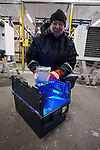 Professor Roland von Bothmer of the Swedish University of Agriculture inside the Global Seed Vault carrying a container of seeds, Svalbard, Norway.