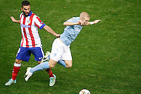 Atletico de Madrid´s Arda Turan and Malmo´s Tinnerholm during Champions League soccer match between Atletico de Madrid and Malmo at Vicente Calderon stadium in Madrid, Spain. October 22, 2014. (ALTERPHOTOS/Victor Blanco)