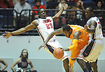 "Tennessee's Kenny Hill (20)  is fouled by Mississippi's Murphy Holloway (31) as Mississippi's Reginald Buckner (23) also defends at the C.M. ""Tad"" Smith Coliseum on Thursday, January 24, 2013. (AP Photo/Oxford Eagle, Bruce Newman)"