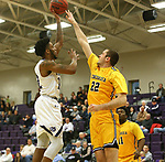 SIOUX FALLS, SD - DECEMBER 7: Justin Taylor #22 from the University of Sioux Falls takes the ball to the basket past Evan Wesenberg #22 from Concordia St. Paul during their game Friday night at the Stewart Center in Sioux Falls, SD. (Photo by Dave Eggen/Inertia)