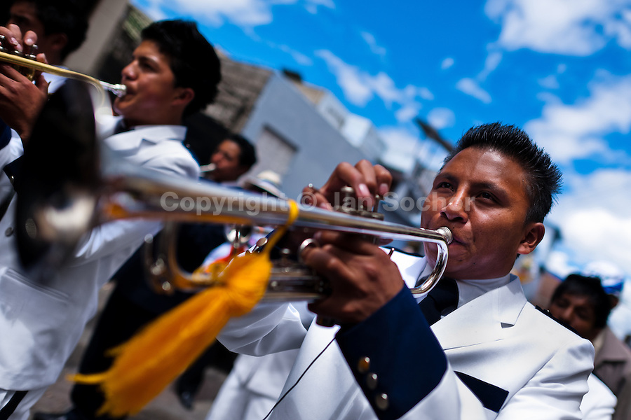 Musicians play trumpet in the religious parade within the Corpus Christi festival in Pujilí, Ecuador, 1 June 2013. Every year in June, thousands of people gather in a small town of Pujili, high in the Andes, to celebrate the Catholic feast of Corpus Christi. Introduced originally during the Spanish conquest of South America, this celebration merges Catholic rituals of Holy Communion with the traditional Andean harvest and sun festivities (Inti, the Inca sun god). Women dancers perform wearing brightly colored costumes while men dancers wear chest ornaments and heavy elaborate headdresses adorned with mirrors, jewelry, or natural items (shells). Being a dancer in the Corpus Christi ceremonial parade (El Danzante) is considered an honour and a privilege by the indigenous people in Ecuador.