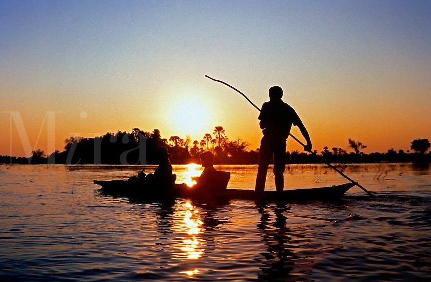 MOKOROS (Boats made of hollowed out logs) are a wonderful way to explore the OKAVANGO DELTA at sunset - BOTSWANA