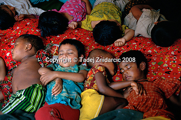 Children sleep in a community based daycare center in Dhaka. Children between ages 2 to 5 come to these centers six times a week.