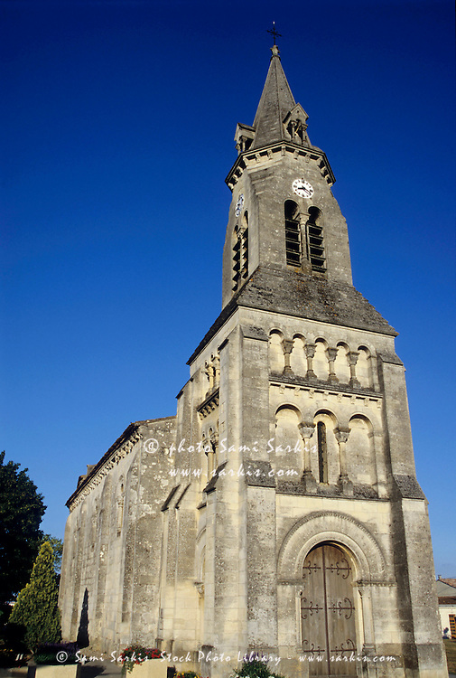 Facade and bell tower of an old church, Bouliac, Gironde, France.
