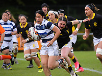 Alisha Print stretches for Tiana Ngawati during the Farah Palmer Cup women's provincial rugby match between Wellington Pride  and Auckland at Jerry Collins Stadium / Porirua Park, Wellington, New Zealand on Saturday, 23 September 2017. Photo: Dave Lintott / lintottphoto.co.nz