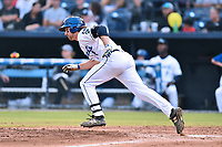 Asheville Tourists shortstop Ryan Vilade (4) runs to first base during a game against the Columbia Fireflies at McCormick Field on August 3, 2018 in Asheville, North Carolina. The Fireflies defeated the Tourists 6-3. (Tony Farlow/Four Seam Images)