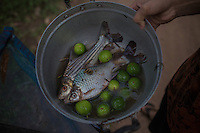 A fisherman shows his daily catch nearby the Liphi Waterfalls. 04/08/2013 © Thomas Cristofoletti / Ruom