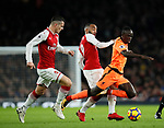 Arsenal's Granit Xhaka and Alexandre Lacazette tussles with Liverpool's Sadio Mane during the premier league match at the Emirates Stadium, London. Picture date 22nd December 2017. Picture credit should read: David Klein/Sportimage