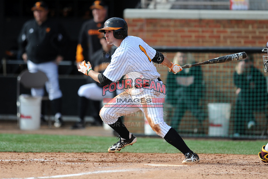 Tennessee Volunteers third baseman Will Maddox #1 swings at a pitch during a game against  the Arizona State Sun Devils at Lindsey Nelson Stadium on February 23, 2013 in Knoxville, Tennessee. The Volunteers won 11-2.(Tony Farlow/Four Seam Images).