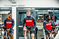 (L-R) Wayne Routledge, Alfie Mawson and Nathan Dyer exercise on bikes during the Swansea City training session at The Fairwood training Ground, Swansea, Wales, UK. Thursday 16 November 2017