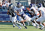 September 15, 2012: Nevada Wolf Pack quater back Cody Fajardo runs out of the tackel of  Northwestern State Demons Cornist Broadway during their NCAA football game played at Mackay Stadium on Saturday afternoon in Reno, Nevada.