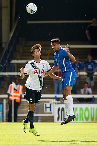 18.07.2015.  Peterborough, Engand. Pre Season Friendly Peterborough United versus Tottenham Hotspur. Ismail Azzaoui (Tottenham Hotspur) and Olutobi Adebayo-Rowling (Peterborough United) jump for a ball.