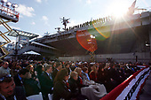 New York, NY - November 11, 2008 -- A large crowd sits alongside the Intrepid while United States President George W. Bush speaks during a Veteran's Day rededication ceremony of the Intrepid Sea, Air and Space Museum in New York City on Tuesday, November 11, 2008. <br /> Credit: John Angelillo - Pool via CNP