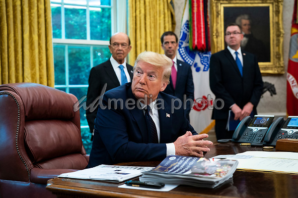 United States President Donald J. Trump makes remarks as he receives a briefing on the 2020 Hurricane Season in the Oval Office, of the White House in Washington, DC onThursday, May 28, 2020. <br /> Credit: Doug Mills / Pool via CNP/AdMedia