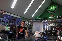 Alfarida dipendente del bar Heineken. Riaperto ad Ottobre 2011..Dopo il terremoto  del 2009 alcuni negozi e attività commerciali riaprono a L'Aquila..After the earthquake of 2009, some shops and businesses reopen in L'Aquila.