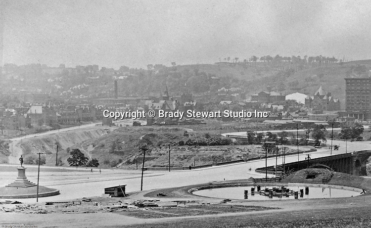 Oakland Section of Pittsburgh:  View of Schenley Park, Schenley Bridge and the Carnegie Institute from Flagstaff Hill - 1907.  Image includes the statue of Edward Manning Bigelow, Director of Public Works, and the Electric Fountain, bottom of Flagstaff Hill.  The Carnegie Institute (Library) is located to the right across the St Pierre Ravine.  Bridge which was built in 1897 by architect Henry Rust.