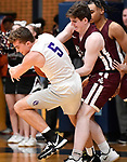Collinsville guard Logan Carlisle (left) and Belleville West forward Tommy Grafe grapple over a rebound. Belleville West played Collinsville in the Class 4A Belleville East regional basketball championship game at Belleville East High School in Belleville, Illinois on Friday March 6, 2020. <br /> Tim Vizer/Special to STLhighschoolsports.com