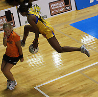 Pulse goalkeep Althea Byfield tries to keep the ball in during the ANZ Netball Championship match between the Central Pulse and Northern Mystics, TSB Bank Arena, Wellington, New Zealand on Monday, 4 May 2009. Photo: Dave Lintott / lintottphoto.co.nz