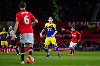 Sunday 05 January 2014<br /> Pictured: Jonjo Shelvey looks on as Jonny Evans of Manchester United passes the ball forward<br /> Re: Manchester Utd FC v Swansea City FA cup third round match at Old Trafford, Manchester