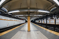 Empty 14th Street subway station platform on the IND line in New York on Friday, July 3, 2015. (© Richard B. Levine)
