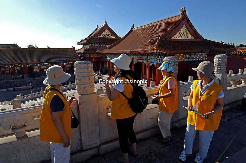 Tourists crowd into the Forbidden City in Beijing, China. The Forbidden City is China's most popular tourist attraction..17 Sep 05