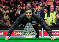 Ronnie O'Sullivan poses with the trophy after the Dafabet Masters FINAL between Barry Hawkins and Ronnie O'Sullivan at Alexandra Palace, London, England on 17 January 2016. Photo by Liam Smith / PRiME Media Images