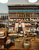 ISRAEL, Tel Aviv, a grocer behind the Cheese and Pickles counter in Delicatessen Restaurant