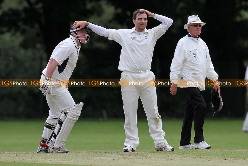 R Lugg of Shenfield pats A Ison on the head after he makes four runs - Shenfield CC vs Upminster CC - Dukes Essex Cricket League Cup Final at Wanstead CC - 29/08/11 - MANDATORY CREDIT: Gavin Ellis/TGSPHOTO - Self billing applies where appropriate - 0845 094 6026 - contact@tgsphoto.co.uk - NO UNPAID USE.
